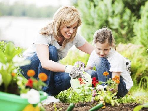woman and child summer gardening